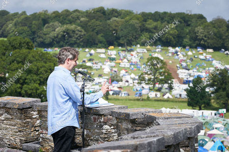 Stock Image of Alan Cox recites 'Whale Nation' from the roof of Port Eliot House, written by, and in remembrance of Heathcote Williams, who died on 1st July 2017.