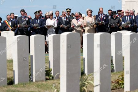 Stock Image of Zonnebeke mayor Dirk Sioen, Vice Chairman Commonwealth War Graves Commission Timothy Laurence, Minister of Defence and Public Service Steven Vandeput, Britain's Catherine (Kate) The Duchess of Cambridge, King Philippe of Belgium, Britain's Prince Charles Prince of Wales, Queen Mathilde of Belgium, Britain's Prince William The Duke of Cambridge, and British Prime Minister Theresa May attend the commemorations at the Tyne Cot Commonwealth War Graves Cemetery, as part of the commemoration for the centary of Passchendaele, the third battle of Ypres, Passendale, Belgium, 31 July 2017.
