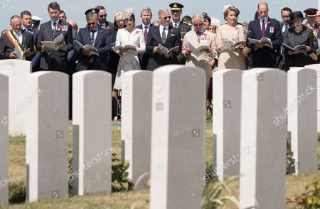 From left, Zonnebeke's mayor Dirk Sioen, Vice Chairman Commonwealth War Graves Commission Timothy Laurence, Minister of Defence and Public Service Steven Vandeput,,Britain's Catherine (Kate) The Duchess of Cambridge, King Philippe of Belgium, Britain's Prince Charles Prince of Wales, Queen Mathilde of Belgium, Britain's Prince William The Duke of Cambridge, and British Prime Minister Theresa May attend the commemorations at the Tyne Cot Commonwealth War Graves Cemetery, as part of the commemoration for the centary of Passchendaele, the third battle of Ypres, Passendale, Belgium, 31 July 2017.