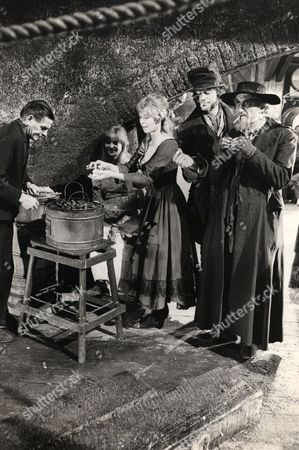 The Cast Of The Film 'oliver' Being Served With Hot Chesnuts During A Break In Filming. Ltor Sheila White Shani Wallis Oliver Reed And Ron Moody.