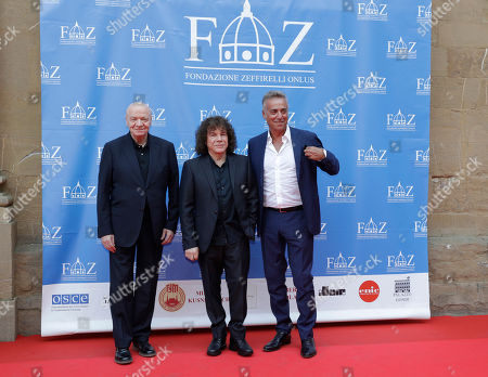 From left, Filippo Crivelli, Riccardo Cocciante and Massimo Ghini arrive on the red carpet of Andrea Bocelli concert that inaugurates the Franco Zeffirelli International Center For Performing Arts, in Florence, Italy, . The center, besides its educational activities, brings together the entire artistic and cultural patrimony of the Italian director's almost 70-year career, including over ten thousand books from his personal library, thousands of professional documents and notes, designs, sketches, scripts, screenplays and storyboards, as well as a substantial collection of photographs of his works from the post-war years to present days