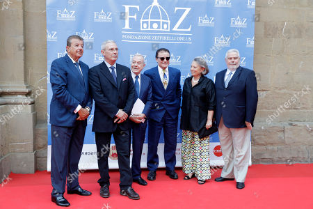 From left producer Tarak Ben Ammar, Pippo Zeffirelli, son of Franco, politician Gianni Letta, singer Massimo Ranieri, and Marquis Condi pose for a photo on the red carpet of Andrea Bocelli concert that inaugurates the Franco Zeffirelli International Center For Performing Arts, in Florence, Italy, . The center, besides its educational activities, brings together the entire artistic and cultural patrimony of the Italian director's almost 70-year career, including over ten thousand books from his personal library, thousands of professional documents and notes, designs, sketches, scripts, screenplays and storyboards, as well as a substantial collection of photographs of his works from the post-war years to present days