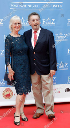 British actor Robert Powell, right, and his wife Babs arrive on the red carpet of Andrea Bocelli concert that inaugurates the Franco Zeffirelli International Center For Performing Arts, in Florence, Italy, . The center, besides its educational activities, brings together the entire artistic and cultural patrimony of the Italian director's almost 70-year career, including over ten thousand books from his personal library, thousands of professional documents and notes, designs, sketches, scripts, screenplays and storyboards, as well as a substantial collection of photographs of his works from the post-war years to present days