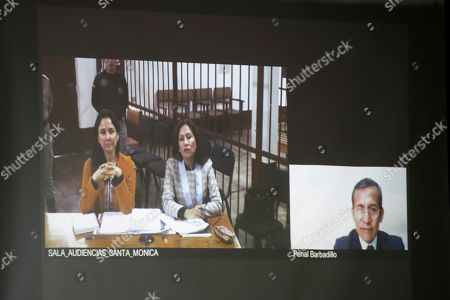 Peru's former President Ollanta Humala, and his wife Nadine Heredia, who are under preventative detention, attend a court hearing via video link, in Lima, Peru, . Earlier this month a judge ordered Humala, and his wife held while they are investigated on allegations of money laundering tied to undeclared campaign contributions from Venezuela and Brazilian construction giant Odebrecht. They have not been charged and they deny the accusations