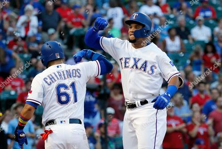 Carlos Gomez, Robinson Chirinos Texas Rangers' Robinson Chirinos (61) and Carlos Gomez celebrate Gomez's solo home run off a pitch from Seattle Mariners' Felix Hernandez in the second inning of a baseball game, in Arlington, Texas