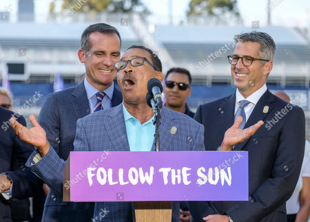 Los Angeles Mayor Eric Garcetti, left, and L.A. Olympic Committee leader Casey Wasserman, right, react as City Council President Herb Wesson speaks during a press conference to make an announcement for the city to host the Olympic Games and Paralympic Games 2028, at StudHub Center in Carson, outside of Los Angeles, Calif