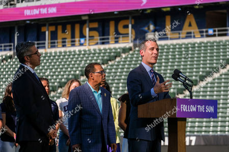 Los Angeles Olympic Committee leader Casey Wasserman, from left, and City Council President Herb look on as L.A. Mayor Eric Garcetti speaks during a press conference to make an announcement for the city to host the Olympic Games and Paralympic Games 2028, at StudHub Center in Carson, outside of Los Angeles, Calif