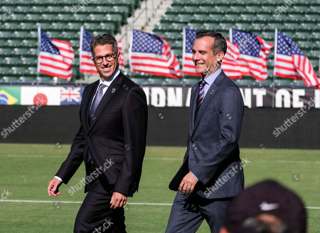 Los Angeles Mayor Eric Garcetti, right, and L.A. Olympic Committee leader Casey Wasserman arrive at a press conference to make an announcement for the city to host the Olympic Games and Paralympic Games 2028, at StudHub Center in Carson, outside of Los Angeles, Calif