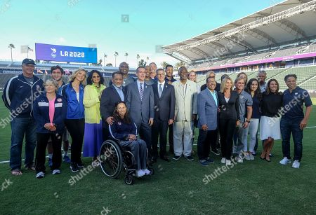 Los Angeles Mayor Eric Garcetti, City Council President Herb Wesson and Bid Chairman Casey Wasserman join the US Women's Soccer Team to make an announcement for the city to host the Olympic Games and Paralympic Games 2028, at StudHub Center in Carson, Calif., in