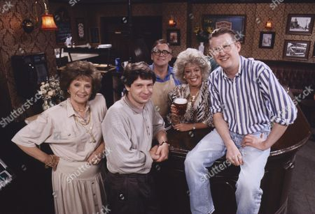 Stock Image of Barbara Knox (as Rita Fairclough), Richard Signy (Director), William Tarmey (as Jack Duckworth), Julie Goodyear (as Bet Gilroy) and Kevin Kennedy (as Curly Watts)