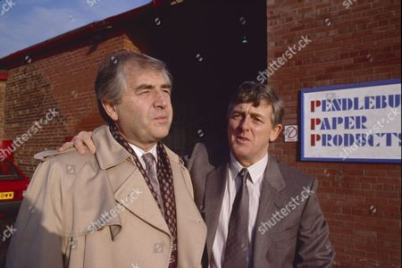 Peter Baldwin (as Derek Wilton) and Christopher Coll (as Victor Pendlebury)