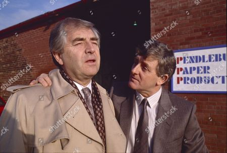 Stock Picture of Peter Baldwin (as Derek Wilton) and Christopher Coll (as Victor Pendlebury)