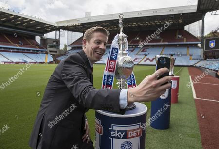 Sky TV reporter Ben Ransom with the EFL trophies at Villa Park