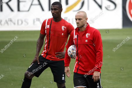 Sion's players midfielder Kevin Constant, left, and forward Marco Schneuwly, right, look on their teammates, during a training session of FC Sion one day before an UEFA Europa League qualifying third round soccer match against FK Suduva, at the Stade de Geneve stadium, in Geneva, Switzerland, Tuesday, August 1, 2017.