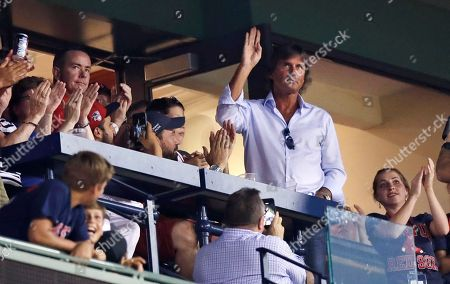 Hall of Fame pitcher Dennis Eckersley waves as fans applaud when he is honored between innings of a baseball game between the Boston Red Sox and Cleveland Indians at Fenway Park, in Boston. Red Sox pitcher David Price was still frustrated Saturday over Eckersley's critical comments about some of his teammates