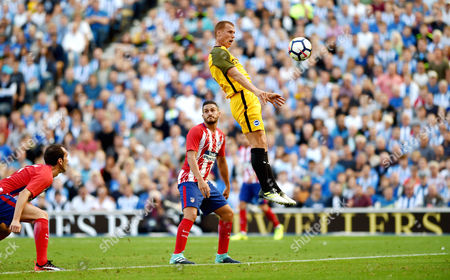 Steve Sidwell heads in Brighton's second goal during the Friendly match between Brighton and Hove Albion and Atletico Madrid at the American Express Community Stadium in Brighton and Hove. 06 Aug 2017