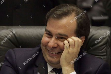 Brazil's Lower House Speaker Rodrigo Maia takes part in a congressional hearing, before a key vote by the lower chamber on whether to suspend President Michel Temer and put him on trial over an alleged bribery scheme to line his pockets, in Brasilia, Brazil, . Temer appeared to have the upper-hand and is confident he can survive bribery charge vote