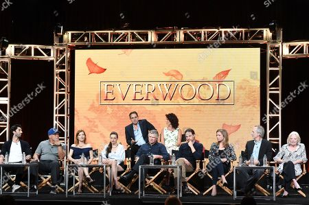 "Stock Picture of Greg Berlanti, back row left, and Rina Mimoun, Justin Baldoni, front row from left, John Beasley, Stephanie Niznik, Vivien Cardone, Treat Williams, Gregory Smith, Emily VanCamp, Tom Amandes, Debra Mooney Greg Berlanti, back row left, and Rina Mimoun, Justin Baldoni, front row from left, John Beasley, Stephanie Niznik, Vivien Cardone, Treat Williams, Gregory Smith, Emily VanCamp, Tom Amandes and Debra Mooneyparticipate in the ""Everwood"" panel during The CW portion of the 2017 Summer TCA's at the Beverly Hilton Hotel, in Beverly Hills, Calif"