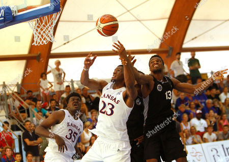Kansas University's Billy Preston, left, is challenged by HSC Roma's Jordan Bayehe during their basketball game in Rome