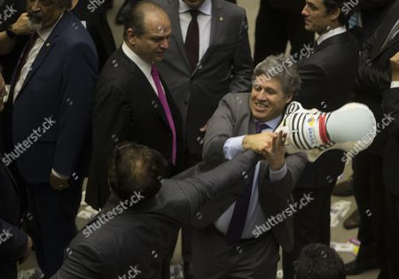 Stock Photo of Paulo Teixeira (R) grabs an inflatable doll out of the hand of Deputies Wladimir Costa (L)  during the corruption vote against Brazilian President Michel Temer, in Brasilia, Brazil, 02 August 2017. Brazil's Chamber of Deputies began the session in which it will decide whether to authorize the Supreme Court to start a criminal trial for corruption against President Temer.