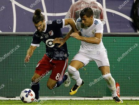 Graham Zusi, Theo Hernandez MLS All-Star's Graham Zusi, left, controls the ball against Real Madrid's Theo Hernandez during the first half of the MLS All-Star Game, in Chicago