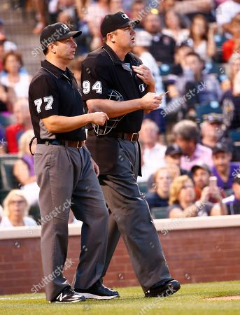 Stock Photo of Umpire Lance Barrett (94) comes onto the field after replacing injured home plate umpire Kerwin Danley during the third inning of a baseball game between the Colorado Rockies and the New York Mets, in Denver