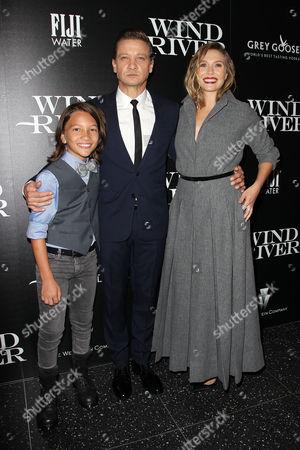 Teo Briones, Jeremy Renner and Elizabeth Olsen