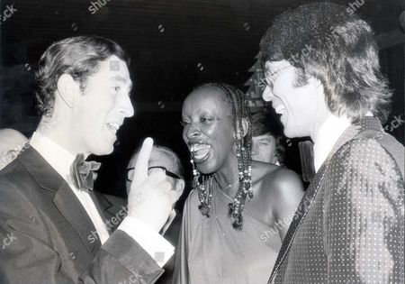 Prince Of Wales July - Dec 1977 29th November 1977 Prince Charles Shares A Joke With Madeline Bell And Cliff Richard At Circus Tavern Purfleet Tonight....royalty