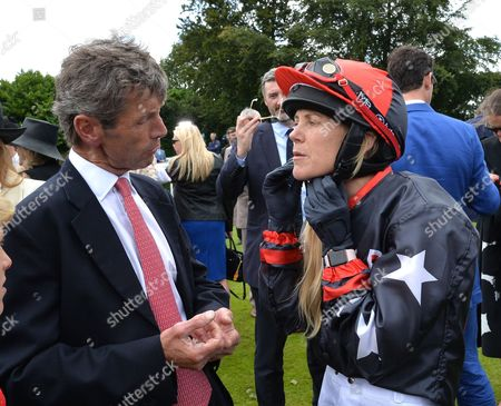 Sarah Ayton chats to Mark Perrett, the trainers husband, before riding Stable Returns in The Magnolia Cup, The Goodwood Ladies Race.