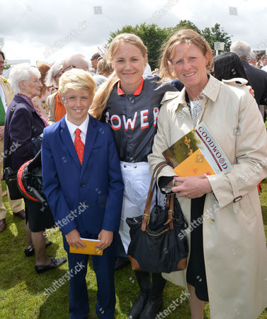 Sarah Ayton with Ryan and Amanda Perrett, the trainer, before riding Stable Returns in The Magnolia Cup, The Goodwood Ladies Race.