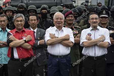 Malaysian Prime Minister Najib Tun Razak (C), Deputy Prime Minister Ahmad Zahid Hamidi (L) and Defence Minister Hishammuddin Hussein (R) pose for a photo with the Malaysian Police Force after the security drill for the upcoming South East Asian Games (SEA GAMES) in Kuala Lumpur, Malaysia, 03 August 2017. The 29th Southeast Asian Games (SEA GAMES) will run from 19 to 30 August 2017 in Malaysia. More than 7,000 athletes from the region are expected to participate in the event.