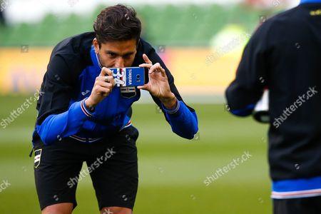 Ricky Alvarez takes a photo on the personalised phone of Samporia's Lucas Torreira
