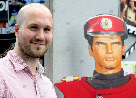 Jamie Anderson son of Gerry Anderson, creater of Thunderbirds, pictured along side a cut out of Scott Tracy from Thunderbirds