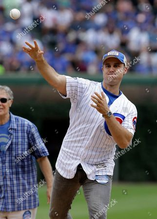 Stock Image of Comedian Chris Witaske throws out a ceremonial first pitch before a baseball game between the Chicago Cubs and the Arizona Diamondbacks, in Chicago