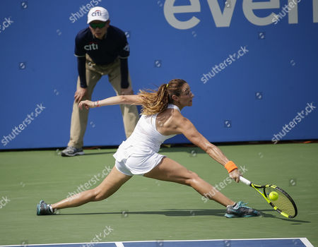 Mariana Duque-Marino (COL) stretches to get to an inbound shot during her lose to Simona Halep (ROU) at the Citi Open tennis tournament being played at Rock Creek Park Tennis Center in Washington, D.C