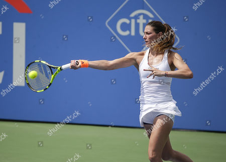Mariana Duque-Marino (COL) plays the ball back to Simona Halep (ROU) at the Citi Open tennis tournament being played at Rock Creek Park Tennis Center in Washington, D.C