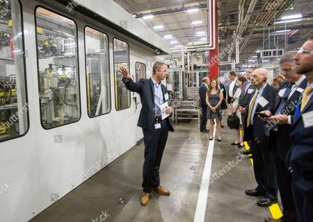 Tim Davis, Director of Operations Dish, BSH Home Appliances, takes state and local officials on a tour, in New Bern, N.C., as part of the 20-year anniversary of manufacturing diswashers in New Bern and expansion of the dish plant