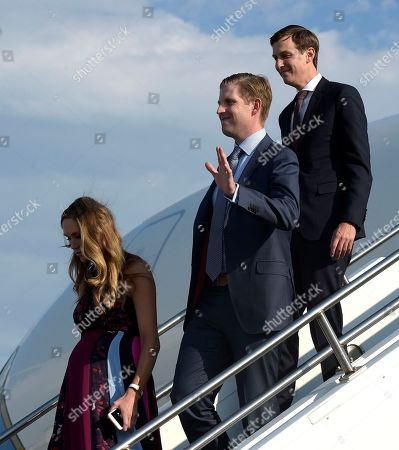 Eric Trump, Jared Kushner, Lara Yunaska Eric Trump, center, waves as he and his wife Lara Yunaska, left, and White House adviser Jared Kushner, right, walk down the steps of Air Force One at Tri-State Airport in Huntington, W.Va., . President Donald Trump is holding a campaign-style rally in Huntington