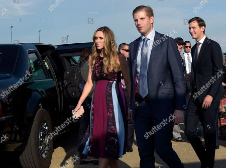 Eric Trump, Jared Kushner, Lara Yunaska Eric Trump, center, his wife Lara Yunaska, left, and White House adviser Jared Kushner, right, walk to their vehicles after arriving via Air Force One at Tri-State Airport in Huntington, W.Va., . President Donald Trump is holding a campaign-style rally in Huntington