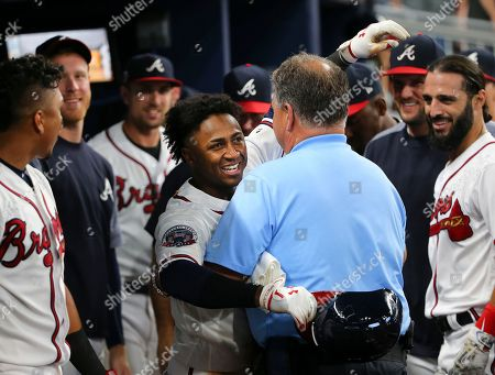Ozzie Albies, Jim Lovell Atlanta Braves rookie second baseman Ozzie Albies embraces trainer Jim Lovell after hitting a three-run home run during the ninth inning of the team's baseball game against the Los Angeles Dodgers, in Atlanta. The Dodgers won 7-4. The homer is Albies' first hit in the majors