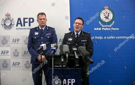 Australian Federal Police Deputy Commissioner Michael Phelan, right, and New South Wales state Police Deputy Commissioner David Hudson discuss details of the charging of two men with terrorism offenses in Sydney, . The men, ages 49 and 32, were each charged with two counts of planning a terrorist act in connection with an alleged plot to bring down an airplane, police said