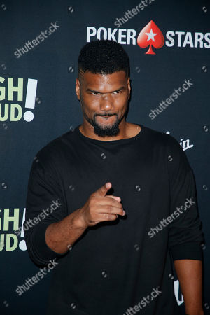 """Stock Photo of Damien Dante Wayans poses at Kevin Hart's """"Laugh Out Loud"""" new streaming video network launch event at the Goldstein Residence, in Beverly Hills, Calif"""