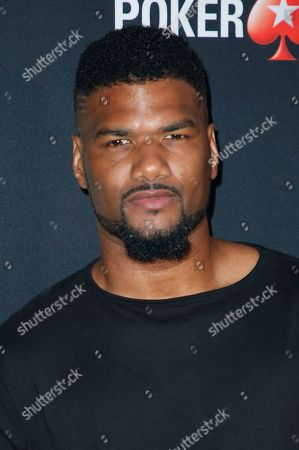 """Stock Image of Damien Dante Wayans poses at Kevin Hart's """"Laugh Out Loud"""" new streaming video network launch event at the Goldstein Residence, in Beverly Hills, Calif"""