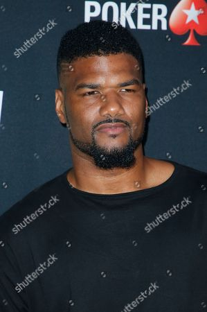 """Damien Dante Wayans poses at Kevin Hart's """"Laugh Out Loud"""" new streaming video network launch event at the Goldstein Residence, in Beverly Hills, Calif"""