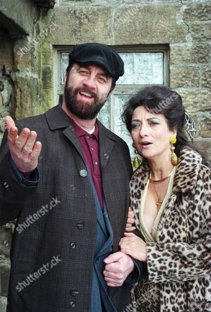 Stock Photo of The Dingles wait for Zak and Nellie to arrive home. They are stunned when he walks through the door and introduces them to a woman named Marilyn instead - With Zak Dingle, as played by Steve Halliwell ; Marilyn, as played by Irene Skillington. (Ep 2067 - 28th March 1996).