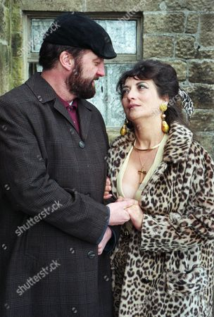 Stock Image of The Dingles wait for Zak and Nellie to arrive home. They are stunned when he walks through the door and introduces them to a woman named Marilyn instead - With Zak Dingle, as played by Steve Halliwell ; Marilyn, as played by Irene Skillington. (Ep 2067 - 28th March 1996).