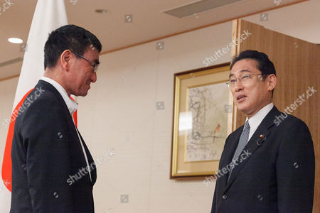 (L to R) Japan's new Foreign Minister Taro Kono meets his predecessor Fumio Kishida during a transfer ceremony