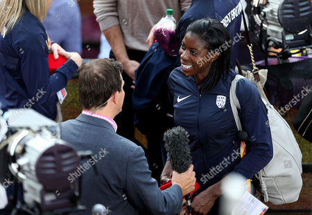 Christine Ohuruogu of Great Britain talks the media after receiving her reallocated bronze medals from the 4x400m Womens relay at the 2011 Daegu Championships