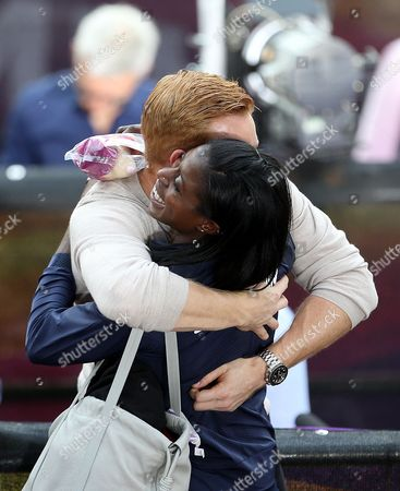 Christine Ohuruogu of Great Britain hugs Greg Rutherford after receiving her reallocated bronze medals from the 4x400m Womens relay at the 2011 Daegu Championships
