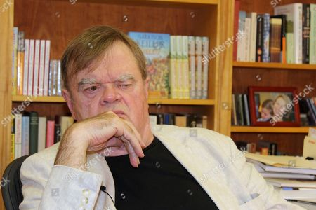 "A Prairie Home Companion"" creator and former host Garrison Keillor talks at his St. Paul, Minn., office. Keillor is not spending his time in retirement baking Powdermilk Biscuits or drinking coffee down at the Chatterbox Cafe now that he has hung up his microphone as host of his popular public radio show ""A Prairie Home Companion."" He turns 75 on Aug. 7 and boards a bus the next day for a 28-city ""Prairie Home Love & Comedy Tour _ 2017,"" which he vows will be his last"